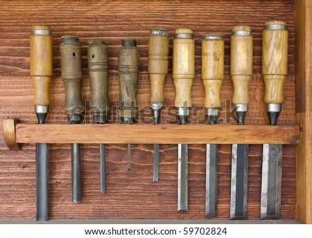 several chisels and gouges in wooden box