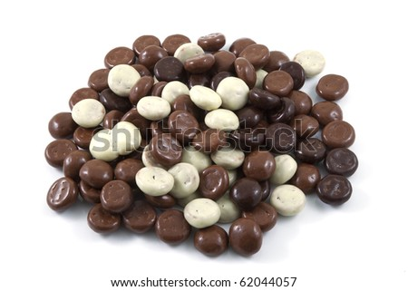 Several chocolate nuts on a white background.