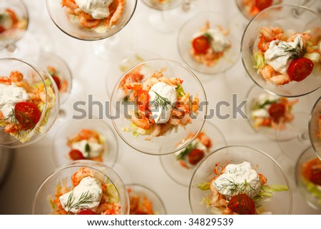 Several cocktail glasses with shrimp salad - stock photo
