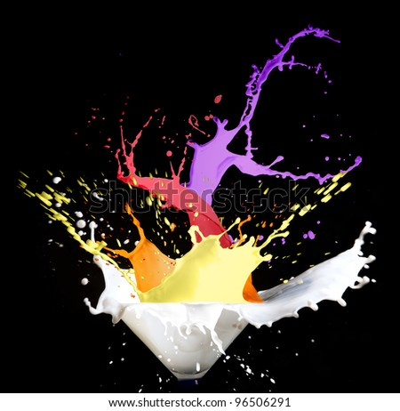 several color splashes on black isolated background - stock photo