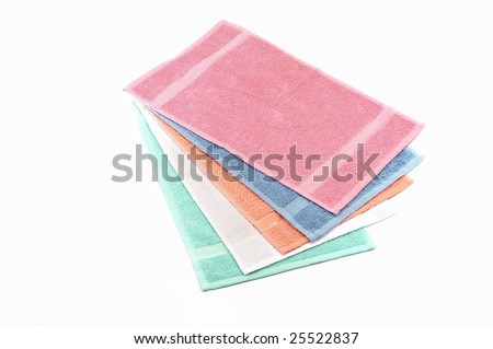 several color towels isolated at white background - stock photo
