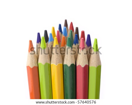 Several colored pencils stand together forming a triangle shape.