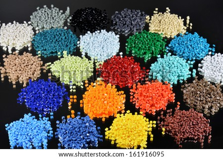 several colored polymer resins on black for injection moulding in laboratory - stock photo