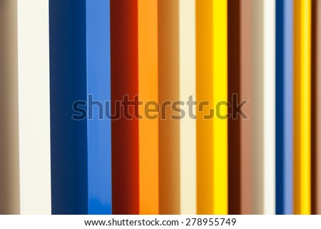 Several colors in prospective painted on wood columns - stock photo