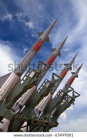 Several combat missiles aimed at the blue sky. Missile weapons. - stock photo