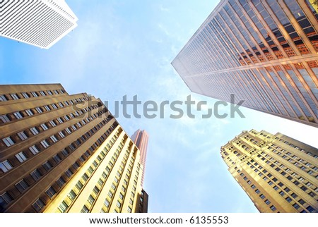 Several corporate buildings in city business center - stock photo