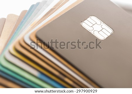 Several credit cards on a concept of consumerism. - stock photo