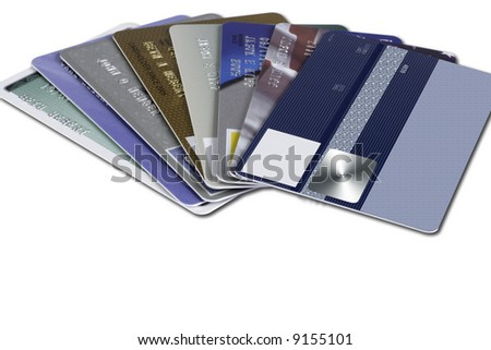 Several credit cards shot fanned out with the top card blank. - stock photo