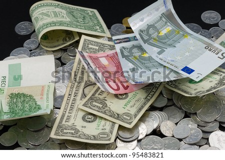 Several different banknotes on the coins background. - stock photo