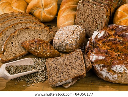 Several different kinds of bread. Healthy diet with fresh baked goods. - stock photo