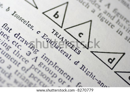 several different triangles are highlighted in an old dictionary in a closeup macro shot