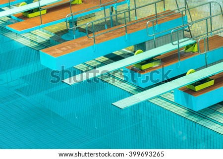 Several diving boards in the swimimg pool. - stock photo