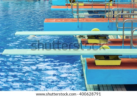 Several diving boards in the swimming pool. - stock photo