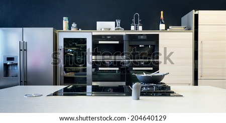 several electronic kitchen equipment with stove and timber front - stock photo