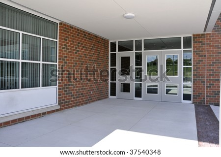 several entry doors for a modern school - stock photo