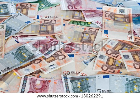 Several euro notes for wallpaper - stock photo