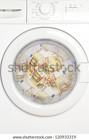 Several fifty euro banknotes washing in the washer. - stock photo