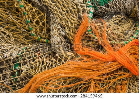 Several Fishing Nets in orange and brown. - stock photo
