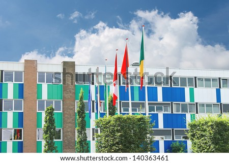 Several flags near the office building - stock photo