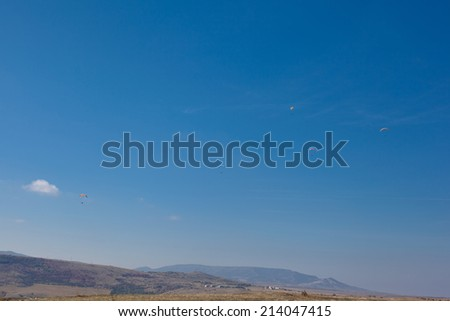 Several flying paparlanes over Klementyev hill in Crimea  - stock photo