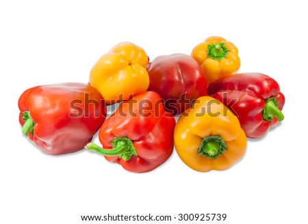 Several fresh red and yellow bell peppers on a light background. Isolation.