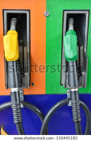 Several gasoline pump nozzles at petrol station, gasoline industry - stock photo