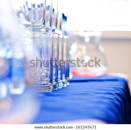 several glass glasses on a blue napkin - stock photo