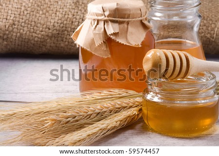 several glass pot with honey - stock photo