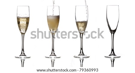 several glasses of champagne, a more full than others - stock photo
