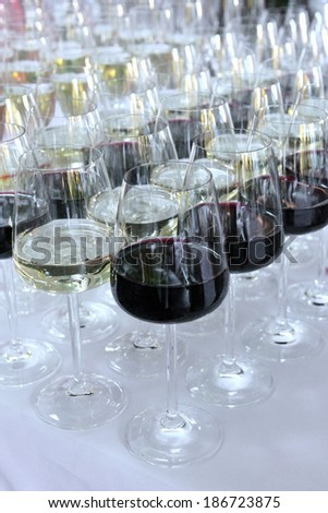 several glasses of red wine on a buffet table - stock photo