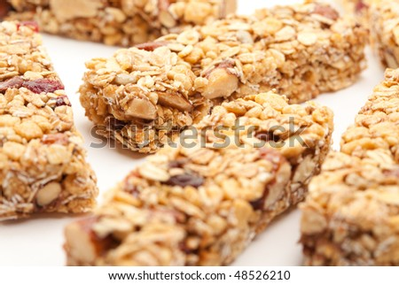 Several Granola Bars Isolated on a White Background with Narrow Depth of Field. - stock photo