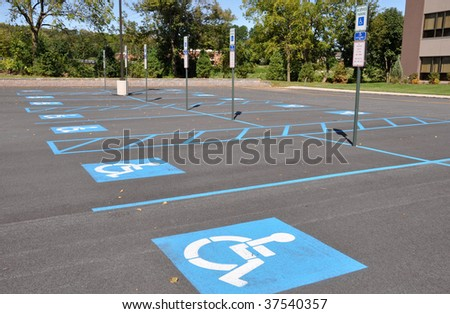 several handicap parking areas in a parking lot - stock photo