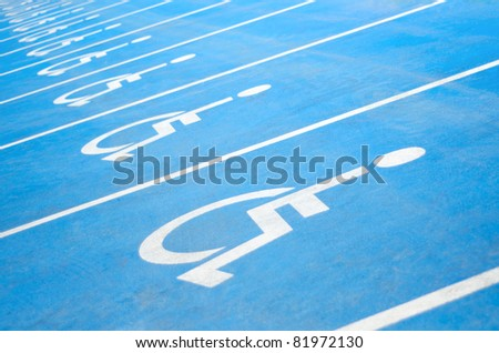 Several handicap parking areas reserved for disabled people - stock photo