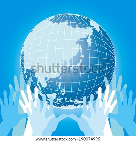 Several hands hold the globe up high on display. - stock photo