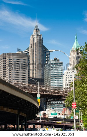 several high-rise buildings and the driveway to the Brooklyn Bridge in downtown manhattan, new york - stock photo