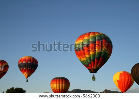 Several hot air balloons during ascend - early morning - stock photo