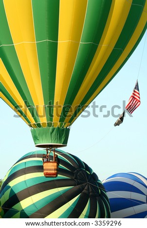Several Hot Air Balloons Taking Off - stock photo