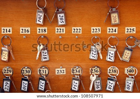 Several hotel keys on wooden board - stock photo