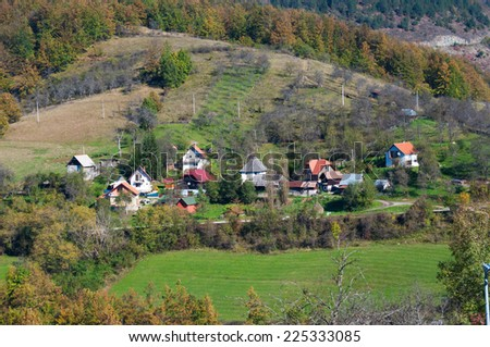 Several houses of village in the mountains - stock photo