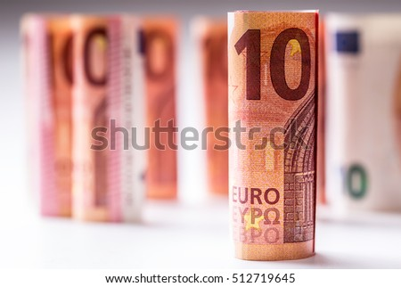 Several hundred euro banknotes stacked by value. Rolled Euro banknotes.Euro currency money. Banknotes stacked on each other in different positions