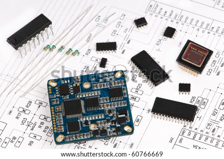 several integrated micro electronics components on microcircuit diagram drawing - stock photo
