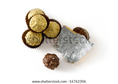 Several isolated chocolate sweets viewed from the top - stock photo