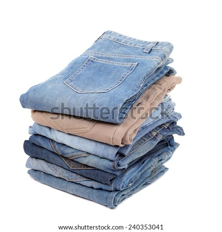 several jeans isolated on white - stock photo
