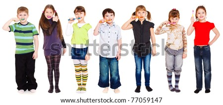 Several kids cleaning teeth or holding toothbrush in hand - stock photo
