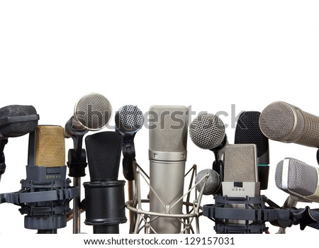 Several kind of conference meeting microphones on white background - stock photo