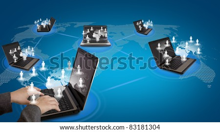 Several laptop computers connected in a social network - stock photo
