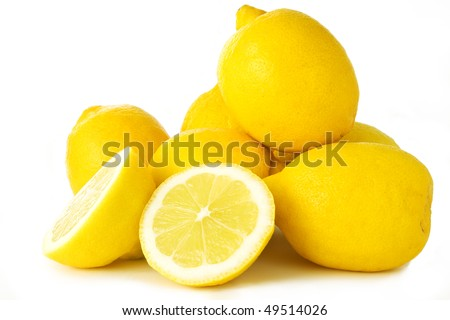 Several lemons, one sliced, isolated on white background