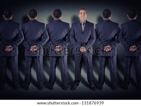 several men back to us and one face - stock photo