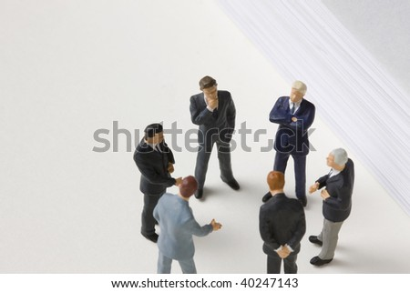 Several men form a ring and are holding a meeting.