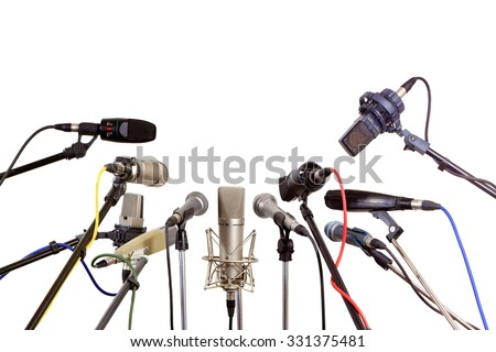Several microphones prepared press conference - isolated on white background  - stock photo